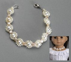 "Pearls Necklace Treat your doll with a real freshwater pearls necklace with a floral design in white and peach. 7-3/4"" long, alloy clasp closure. fits all 18"" Dolls"
