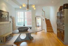 Groundwork helped to stage a beautifully restored early 19th century Philadelphia row house that was on the market. The chandelier is by Robert Ogden.  #table #reclaimedtable #interiordesign #homestaging #robertogden #interiordecorating #table #interior #kitchen #organic #design #organicdesign #contemporary #contemporarydesign #philadelphia #marble #marbletable #marbletabletop #entertaining