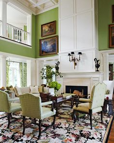 A Floral Rug Grounds The Two Story Living Room And Towering Mantel Brought To