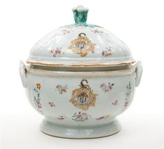 Chinese Export Porcelain Armorial Covered Tureen  Qianlong Period, circa 1755  Of circular form, painted with colorful floral sprays and the arms of Brackwell, flanked by C-scroll handles and surmounted by a conforming pierced lid with a foliate knob.