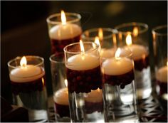 cranberry candles i've done this and with a layer of small pinecones....looks really pretty
