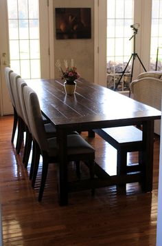Farmhouse Dining Table and Bench {I LOVE everything she did to this table. I never thought of beating it with a chain to get that distressed look!}