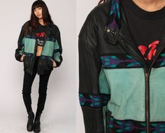 "Vintage 80s jacket in black and mint green leather with tribal print trim. Unisex.  Every item we sell is authentic vintage and one-of-a-kind! You will receive the EXACT item shown in the photos. For reference, model is 5'9"" and measures 34-24-35. DETAILS  Best fits: labeled Extra Large (Note: We only have ONE in stock. If more than one size is listed it is because this item will work on a range of sizes. Check measurements for exact fit.) Condition: very good vintage with light general…"