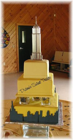 Black & Yellow tiered wedding cake with NYC skyline & Empire State Building details by Diane's Sweet Treats - (Diane Burke), via Flickr