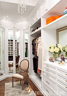 Corner space used to create a three-way mirror makes the galley space feel as if it goes on forever! - Photo: Michael Garland / Design: Lisa Adams