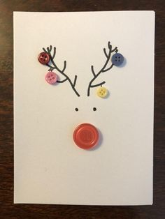 Button Reindeer Card - - White card with buttons and black market to create a reindeer with baubles hanging from the antlers. Button Christmas Cards, Christmas Buttons, Christmas Card Crafts, Homemade Christmas Cards, Printable Christmas Cards, Christmas Cards To Make, Homemade Cards, Handmade Christmas, Christmas Decorations