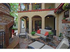 Gorgeous Mediterranean backyard set-up with brick fireplace and string lights. 4417 Grimes Avenue S, Edina, MN.