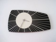 This retro black and white wall clock is really interesting. Although, I wish I could see the numbers from here to see if they are right for me.