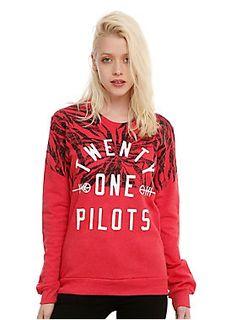 "<p>Red pullover top from Twenty One Pilots with a half-patterned logo design on front.</p> <ul> <li><span id=""bullet0"">50% cotton; 50% polyester</span></li> <li><span id=""bullet1"">Wash cold; dry low</span></li> <li><span>Made in USA</span></li> <li><span>Listed in junior sizes</span></li> </ul>"