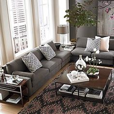 Modern couch with rustic accents. Love the gray and cream walls for neutrals then pop of color in pillows and accessories. :) Bassett Furniture: Gray Sofa & Beige Walls : L-Shaped Sectional Living Room Color Schemes, Living Room Colors, Living Room Grey, Living Room Sofa, Home Living Room, Living Room Designs, Colour Schemes, Charcoal Sofa Living Room, Cozy Living