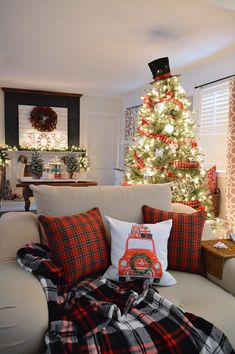 Cottage Christmas Home Tour - JOY Fireplace Mantel -Decorating with classic red and plaid at foxhollowcottage.com