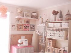 Sweet, adorable, and pink.  I need room for 3 sewing machines though.  I love the cute boxes on the shelves.