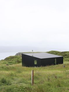 Black house near Dunvegan on the Isle of Skye. Black contemporary house near Dunvegan on the Isle of Skye Cabin Design, House Design, House Cladding, Wood Cladding, Black Architecture, Contemporary Barn, Rural Retreats, Timber House, Building Exterior