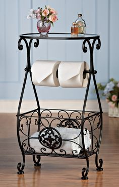 Bathroom Decor Glasstop Bathroom Storage Table Elegant bathroom table has a timeless design and intricate details. Features an oval glass top, a rod for holding 2 rolls of paper, plus a scrolled basket below that's perfect for towels, magazines and more. Some assembly req. Iron, glass. 15 1/4″L x 10″W x 25 3/4″H http://domesticdivascoupons.com/bathroom-decor-glasstop-bathroom-storage-table/