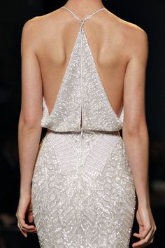 beautiful designed back. wish i knew who this was...looks like marchesa or elie saab but, the shimmery white is lovely.