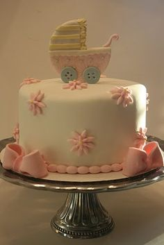 Baby shower cake: pink accents for girl, blue for boy.