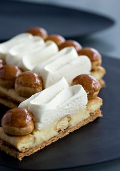 Saint-Honoré at La Patisserie des Rêves, has a famed boutique pastry brand. Classic French dessert with a circle of puff pastry at its base + a ring of puff pastry piped on the outer edge. Fancy Desserts, Just Desserts, Delicious Desserts, Dessert Recipes, Sweet Pastries, French Pastries, Eclairs, Parisian Cake, Boutique Patisserie