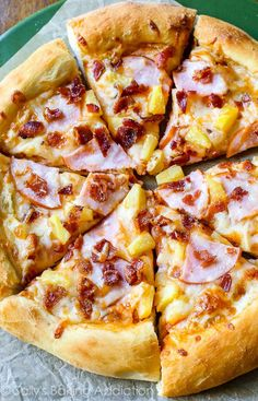 Hawaiian Pizza by sallysbakingaddic…. This crowd-pleasing recipe starts with m… Hawaiian Pizza by sallysbakingaddic…. This crowd-pleasing recipe starts with my fluffy homemade pizza crust and is finished with a sp… Pizza Legal, Pizza Hawaii, Hawaii Hawaii, Ham And Pineapple Pizza, Pineapple Recipes, Pizza Gourmet, Pizza Facil, Bacon Pizza, Sallys Baking Addiction