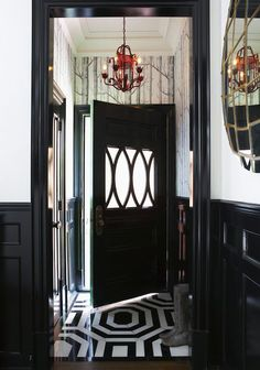 Foyers with painted wainscoting/wood paneling