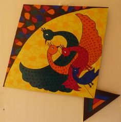 This is a hand painted wooden kite. The designs are inspired by the tribal Gond art of Madhya Pradesh, India.