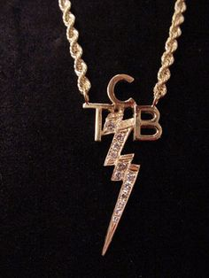 Elviss gold tree of life pendant elvis cherished this item of tcb necklace elvis and priscilla customized the taking care of business logo necklace mozeypictures Gallery