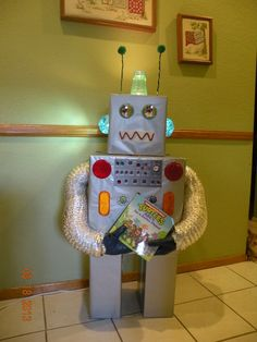 Here's the robot I made to go along with the theme. He holds different books for reading suggestions. I'm currently holding a contest to name him. A SECOND GRADER WON> HIS NAME IS ROBUDDY!
