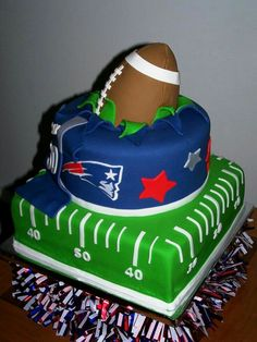 "10"", 8"" half football cake (all ROUND cakes) serves 52 $182 ($3.50) team logos facing each other"