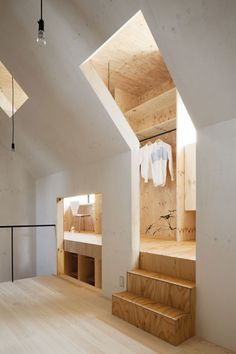 Larch plywood clads personal spaces which wrap around a central living area in a Japanese home by MA-style Architects. - Architecture and Home Decor - Bedroom - Bathroom - Kitchen And Living Room Interior Design Decorating Ideas -