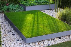 24 May 2005, London, England, UK --- Garden called In The Grove by Christopher Bradley Hole, features blocks of lawn planted in formal 'grove' style, at The Chelsea Flower Show 2005 in London.