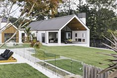 White plaster is contrasted with Western red cedar accents in the cladding for this home. Plaster House, Gable House, Modern Barn House, Shed Homes, Facade House, Architecture, Exterior Design, Future House, Building A House