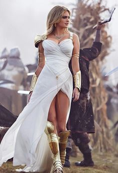 Kate Upton dressed in an ancient costume with a large tear lefting her legs in plain view & a deep neckline, portrays the role of Greek Goddess ''ATHENA'' in the ''Game of War - Fire Age'', a strategy video game. The Deal Elle Kennedy, Warrior Outfit, Fantasy Gowns, Warrior Princess, Character Outfits, Costume Design, Dress Up, Dress Girl, Prom Dress