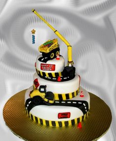 Construction Themed Birthday Cake - I made this construction themed cake for a one-year old's birthday party. It's all edible except for the candle and one support within the crane.