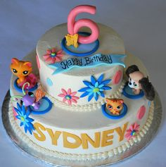 littlest pet shop cake with furry dog,kitten,butterfly and cat