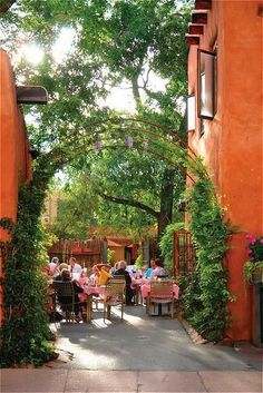 Patio of the Pink Adobe, this wasn't here growing up in SF, in this case it's good. New Mexican eats including green chile & enchiladas in an eclectic, 350-year-old adobe house. Visit Santa Fe, rent a cozy historic adobe home in town, good winter rates, walking distance to the plaza, check it out Airbnb 2562597, Winter in New Mexico is beautiful for skiing, snow shoeing and hikes under the full moon #vacationrental