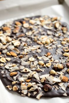 "Crazy Good Coconut Oil ""Chocolate"" Bark •1/4 cup raw hazelnuts •1/4 cup raw almonds •1/3 cup large flake dried coconut •1/2 cup virgin coconut oil •1/2 cup cocoa or cacao powder, sifted if necessary •1/4 cup pure maple syrup •1 tablespoon smooth almond butter, optional"