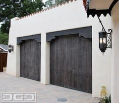 Rustic Wire-Brushed Spanish Colonial Garage Doors With Decorative Hammered Iron Clavos. Perfect for a Spanish Style Orange County, CA Home! Unique Garage Doors, Custom Garage Doors, Wooden Garage Doors, Garage Door Design, Spanish Colonial Homes, Spanish Style Homes, Spanish Revival, Spanish House, Exterior Paint