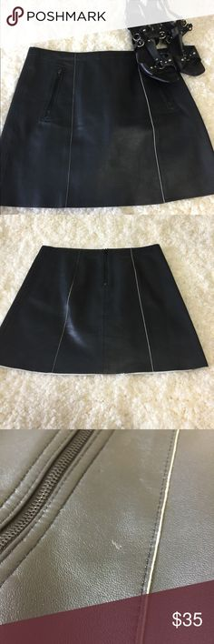 Black leather skirt 100% leather. 2 zip pockets in front, zips in the back. Worn once. 2 tiny spots in front where leather has a small flaw. Not very noticeable at all , just want buyer to be aware. Skirts Mini