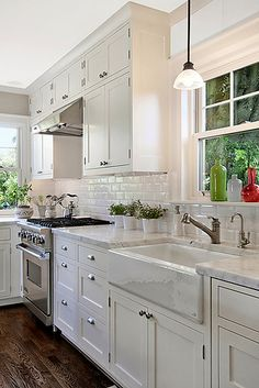 My style : Farmhouse sink, tapware, subway tile, combination drawer knows, marble bench top and high cupboards.