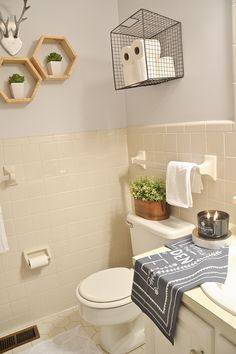 LMB Rental Bathroom Makeover - Pt. 4 Final Reveal - I'm loving the tin/faux plant on the toilet tank