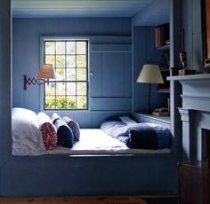 BLUE HEAVEN , designer Steven Gambrel's Sag Harbor home's guest bedroom in a loverly shade of blue with contrasting trim. wide plank pine floors, wide plank walls and ceilings.  photo:eric Plaseckl via:markdsikes.com