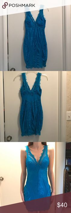 Bebe Sexy Blue Dress This dress is super sexy! It was only worn a few times and is in excellent condition! It is perfect for a party or a night out with the girls! It has built in padding for extra support. The Lacey details are just so pretty! bebe Dresses Mini
