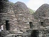 "1,400-900 years ago, Irish Celtic Monks assembled these beehive-shaped stone huts on the rock island of Skellig Michael off the w coast of Ireland. No mortar was used---yet even today these stone huts are still perfectly water-tight! ""Skellig"" means ""Rock"". During the Middle Ages high places were often named for the Archangel Michael."