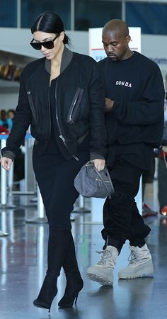 Kim Kardashian kept her look sleek in all-black. She met her pants with a structured bomber jacket, toted a simple gray bag, and opted for suede heeled boots, while Kanye stayed casual in his high-tops.