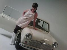 Suzy Perry is an English television presenter, best known for covering MotoGP / Formula One. Shown here with her Morris Mini
