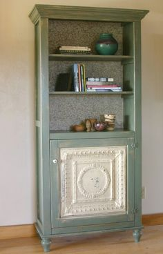 Pressed tin furniture--for that tin ceiling tile I have, matching bookcases :)