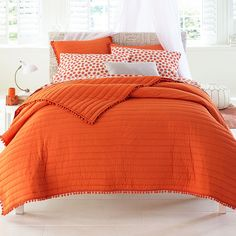 Drenched in bold crayon colors and edged with fun pom pom trim, this cotton quilt looks wonderful on its own or layered with your favorite coordinating print.   solid reverse 100% cotton fluffed with hypo-allergenic fill kept in place with rib quilting machine wash imported   Why Buy? Perfect for spring, our bright bedding solutions add pops of color to your space at great prices.