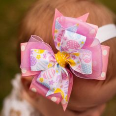 This adorable bow is perfect for Easter. This bow features Polka Dot, Sheer and super cute Easter Egg Ribbon. This bow measures approx. 4 inches