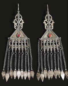 Turkestan | Pair of temporal pendants ~ engse lik ~ from the Tekke people | Silver and carnelian | 20th century