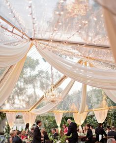 Photos that inspire us…gorgeous combination of a clear tent, twinkle lights and partial swagging. #partyrentals #celebrations