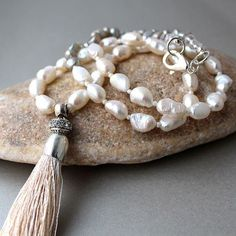 Gorgeous long boho freshwater pearl necklace with luxurious silky cream tassel Silver grey and cream baroque pearls form the main part of this